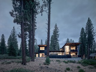 A Family's California Ski Retreat is Designed to Blend in With Its Site - Photo 5 of 5 - The structure is divided into two solid vertical volumes connected by glazed living areas. The cedar cladding and steel panels reflect the hues of the surrounding forest.