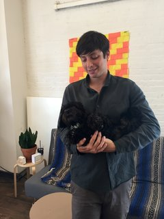 Inside the Designer's Studio: Good Thing - Photo 1 of 5 - Good Thing founder Jamie Wolfond holds office mascot Arthur in the Brooklyn office of his manufacturing brand, Good Thing.