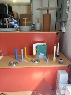 Inside the Designer's Studio: Good Thing - Photo 2 of 5 - A selection of Good Thing favorites, including the Slim bookends byKenyon Yeh, Spiral trivet set and Paper Display bySam Anderson and Jamie Wolfond, and Anderson's Field candle holders, sit side-by-side on a colorful display.