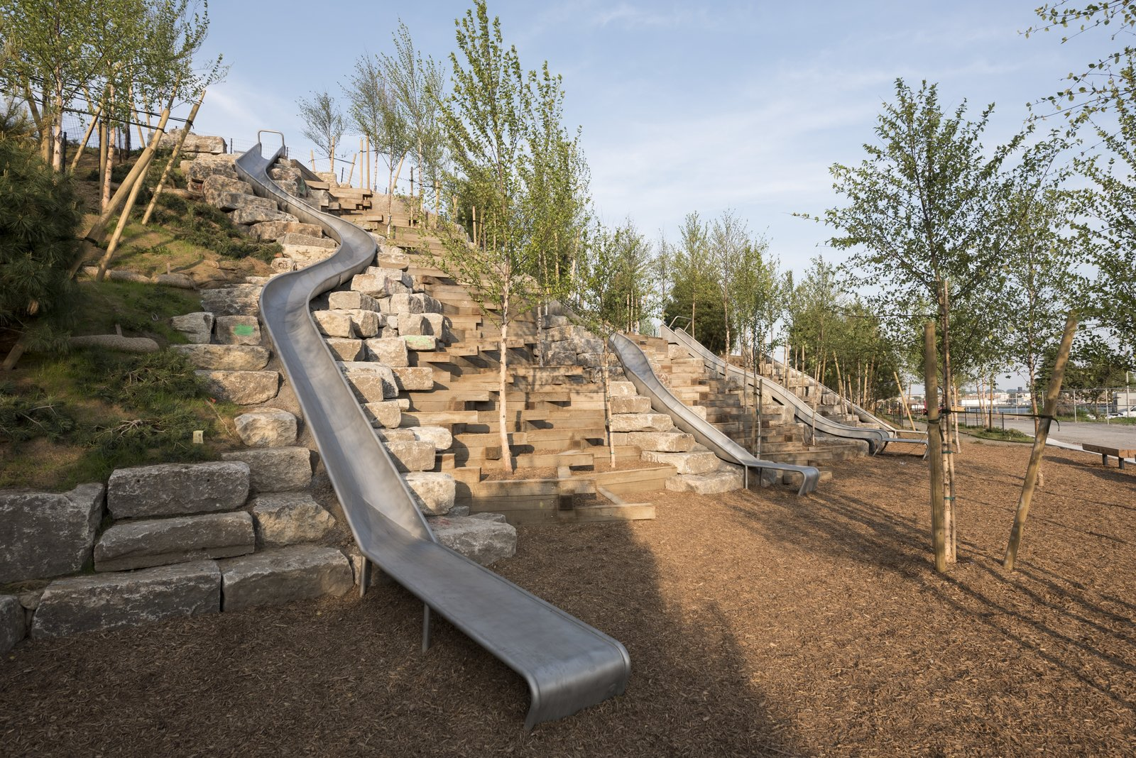 Slide Hill offers an interactive platform for play that includes a universally accessible path and the longest sliding board in the city.