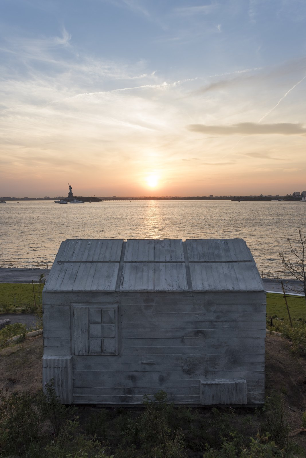 The landscape design will serve as a platform for public art, beginning with British artist Rachel Whiteread's <i>Cabin</i>, an otherworldly architectural installation on the tip of Discovery Hill.  Photo 4 of 6 in New York's Newest Park Sits on Recycled Demolition Debris