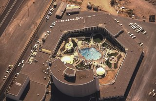 The Architecture of Excess: Caesars Palace at 50 - Photo 6 of 7 - An ariel view of Caesars Palace and the Gardens of the Gods pool oasis, circa 1970.
