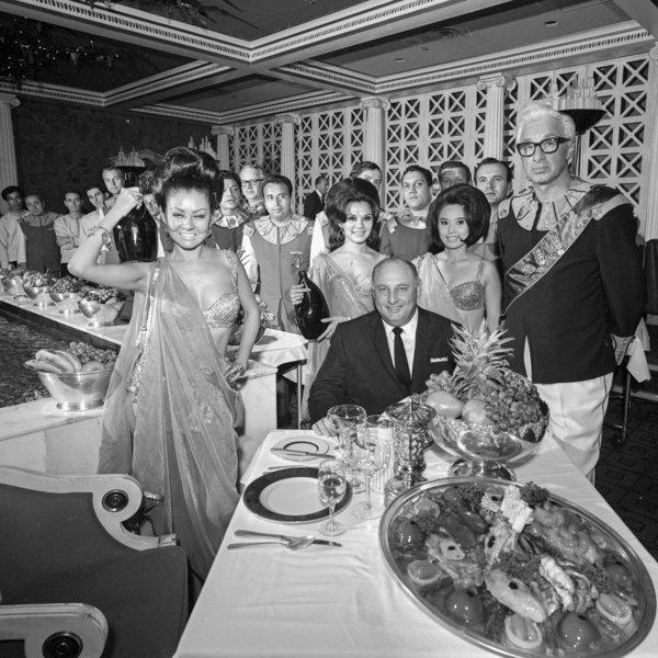 Caesars founder Jay Sarno enjoys a feast the the original Bacchanal restaurant, 1967.