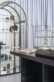 This Brooklyn Boutique Is an Oasis of Calm in the Busy City - Photo 4 of 6 - A vintage 1970s mirrored case by the Design Institute of America displays select treasures on the back wall of the shop.
