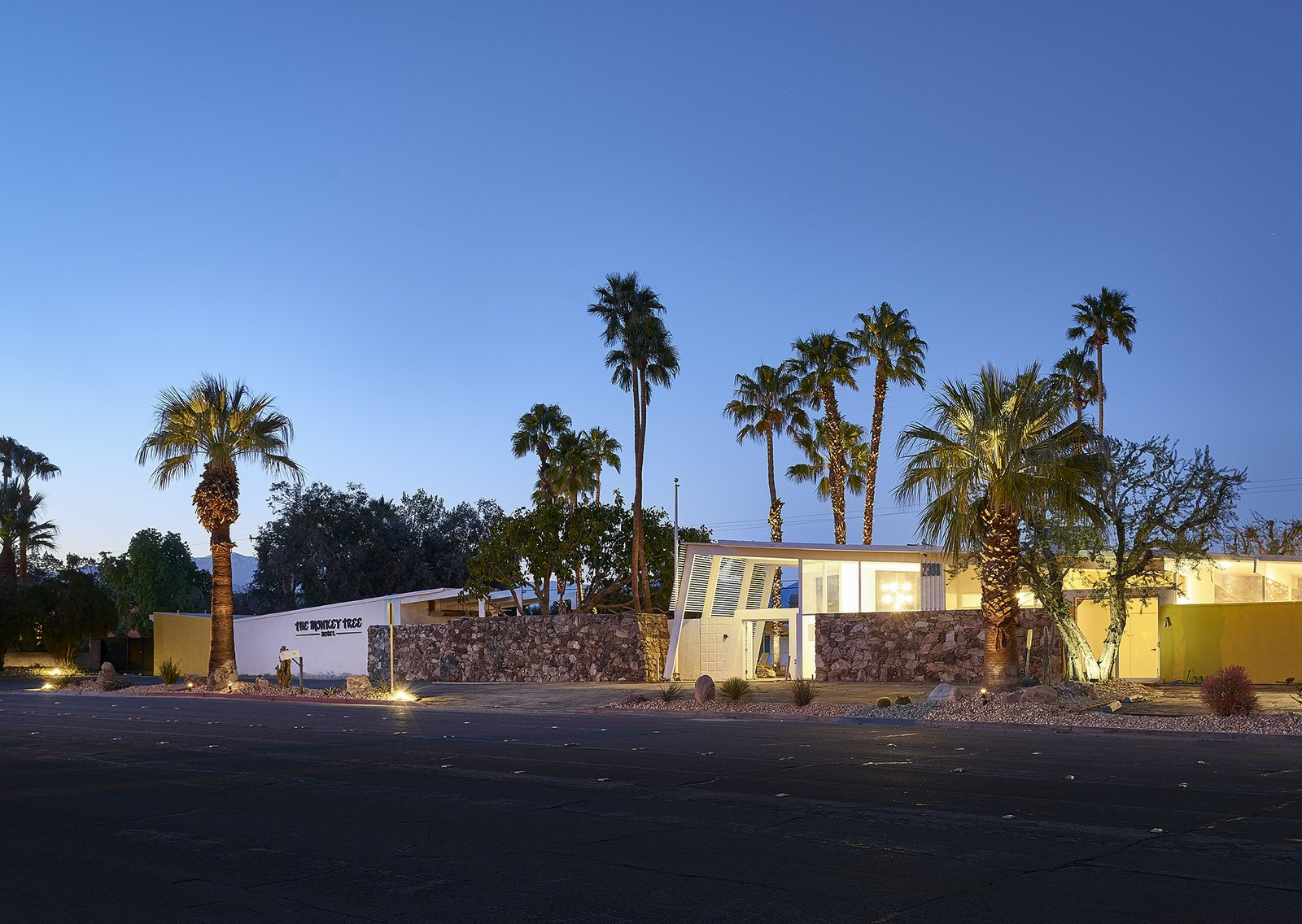 Tagged: Exterior, Stone Siding Material, House, and Mid-Century Building Type.  Photo 1 of 6 in This Palm Springs Hotel is Filled with Vintage Midcentury Modern Finds