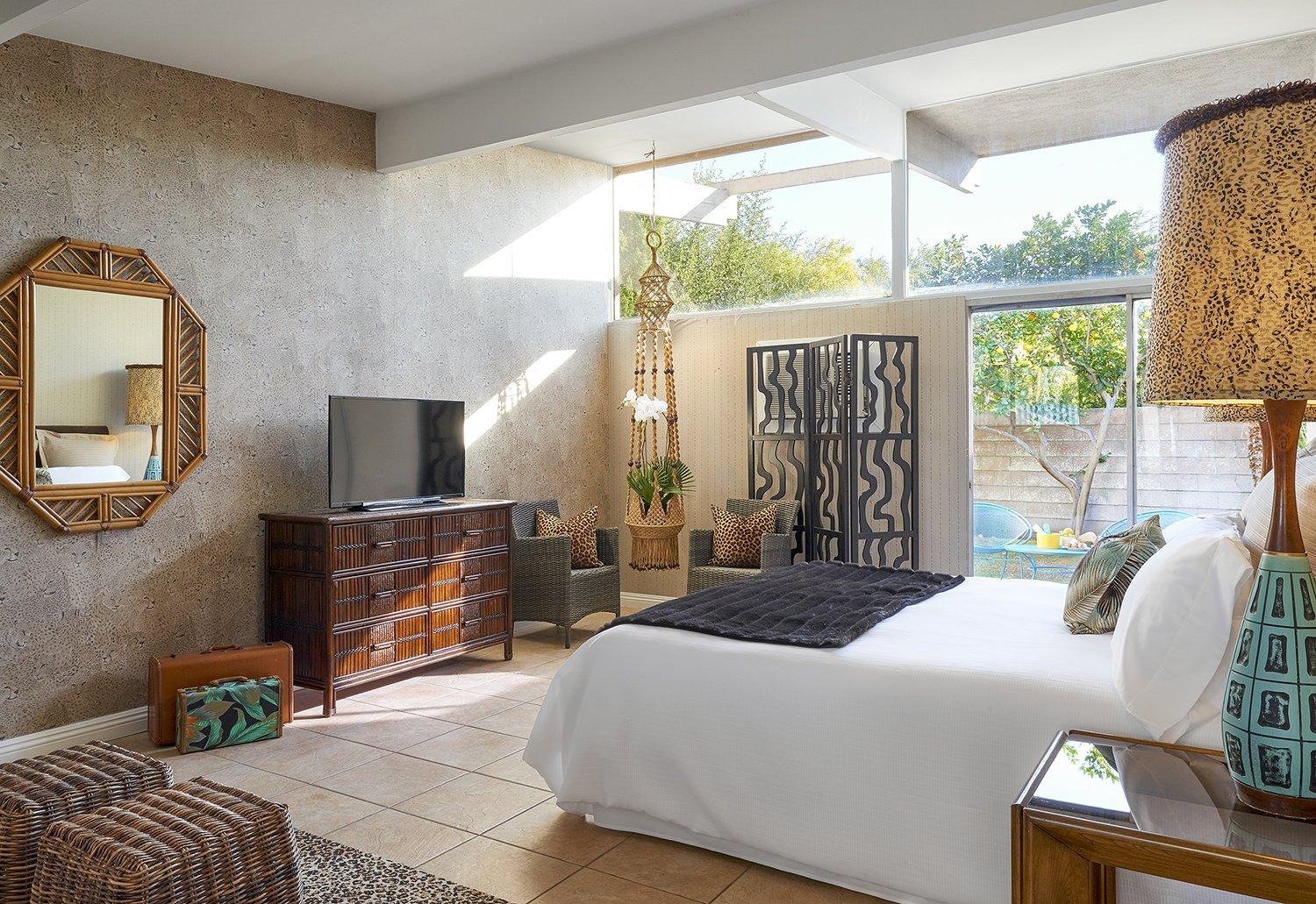 The new hotel's Jungle bedroom, stocked with finds from places like The Estate Sale Company, where it's not unusual to find treasures from the Parker Palm Springs, located just across the street. Other scores came from the now-shuttered Lot 58 auction house. Midcentury Homes by Dwell