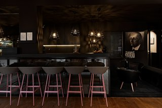Inspired by the Sharing Economy, This Frankfurt Hotel Feels Just Like Home - Photo 5 of 7 - The bar at Libertine Lindenberg features a dark and moody color palette.