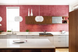 Red, Red, and More Red! 20 Bold Interiors That Make a Statement - Photo 17 of 20 - The kitchen's red Venetian plaster walls are a nod to a detail in the family's previous apartment. The walnut and lacquer kitchen system is by Henrybuilt.<br><br>Photo by Howie Guja<br>Styling by Gorilla Styling