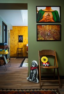 This Wisconsin Hotel Suite Conjures the Best of Summer Camp—Hold the Bug Spray - Photo 3 of 9 - Art and games throughout the space invoke camp memories. Much of the art and accessories, like the photographs above, come from the Camp Wandawega Land of Nod collaboration.