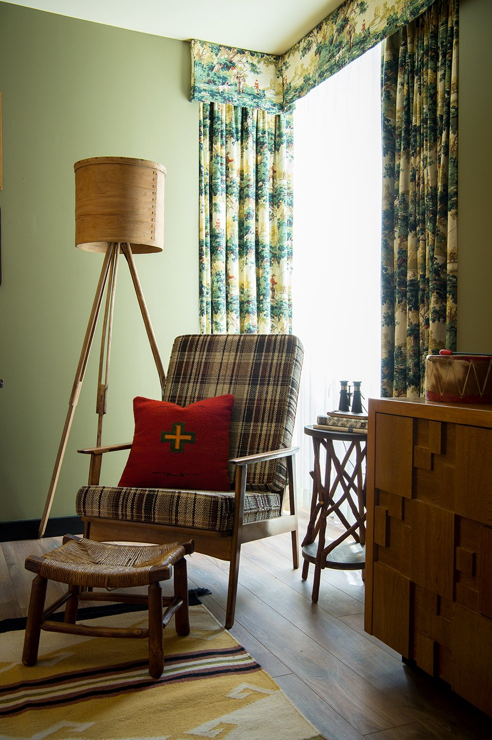 Hunting print draperies complement accessories and toys from the Camp Wandawega Land of Nod collaboration.  Photo 9 of 10 in This Wisconsin Hotel Suite Conjures the Best of Summer Camp—Hold the Bug Spray