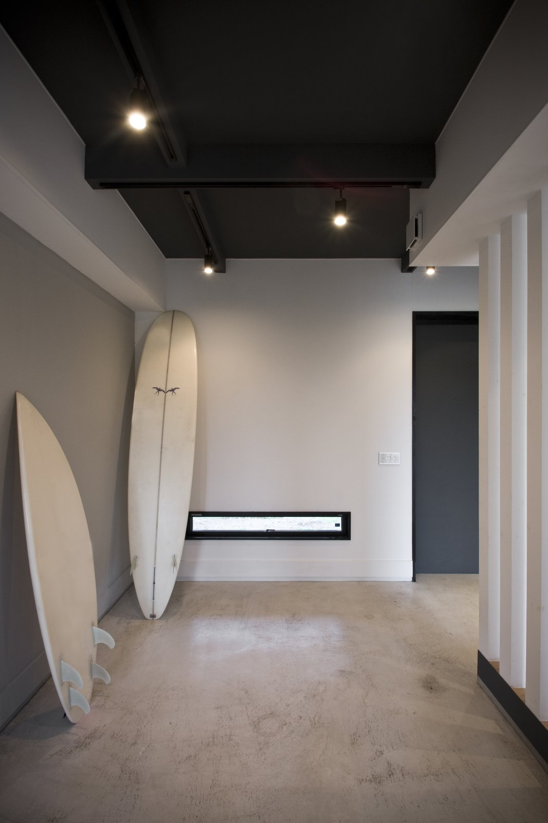 The family's love of surfing was a main inspiration for the space. It is designed to be a relaxing getaway with few distractions from the sea and surrounding nature.  Photo 5 of 7 in This Minimal Japanese Getaway Was Built for Surfing