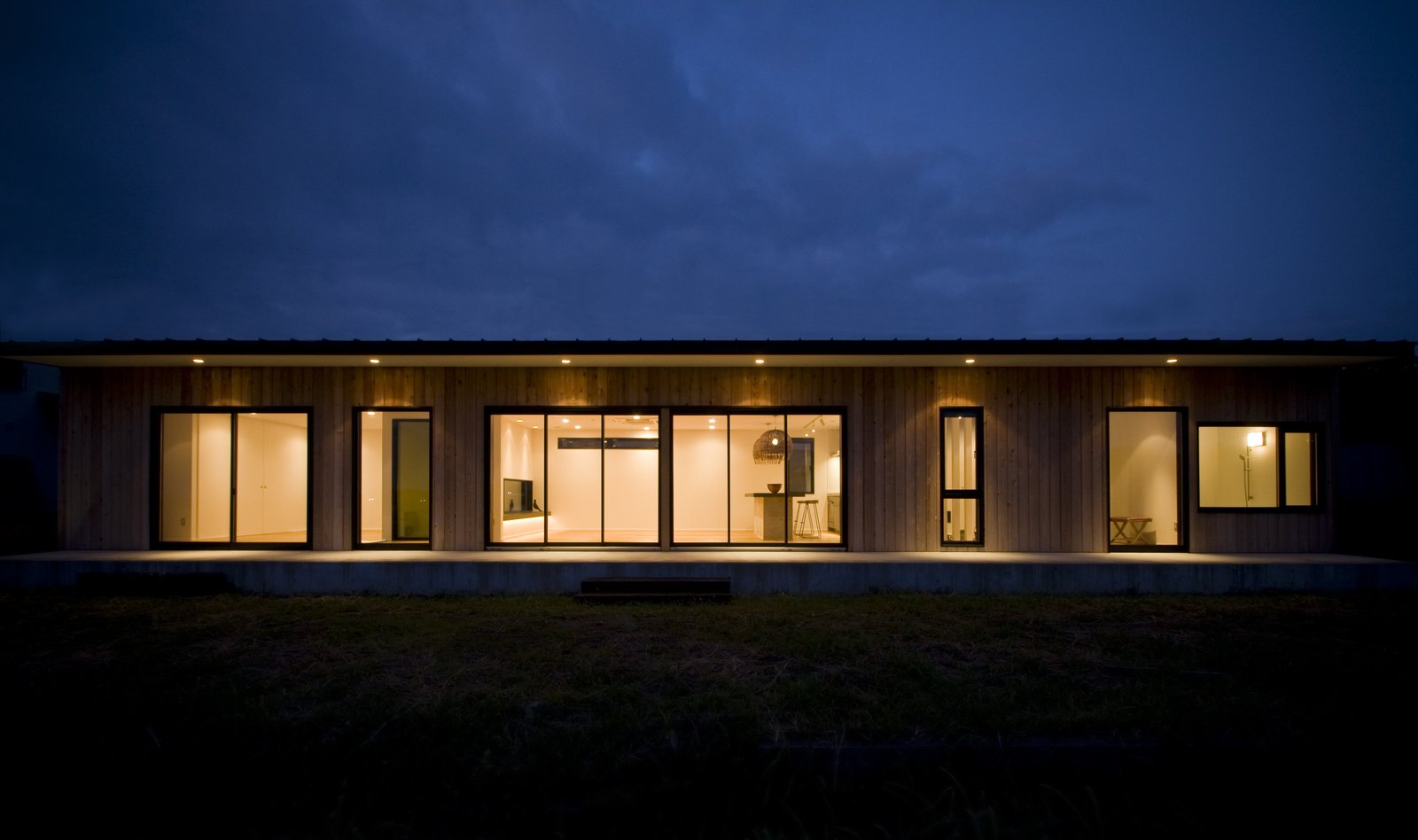 Vast expanses of windows connect the home to its site.  Photo 7 of 7 in This Minimal Japanese Getaway Was Built for Surfing