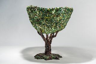 """Breaking the Mold: A Conversation With Architect, Artist, and Iconoclast Gaetano Pesce - Photo 5 of 6 - The tree vase is the result of a mosaic or decoupage technique in which pieces of resin were collaged on the surface to mimic foliage. """"When you have new possibilities your ideas become more at reach,"""" Pesce says."""