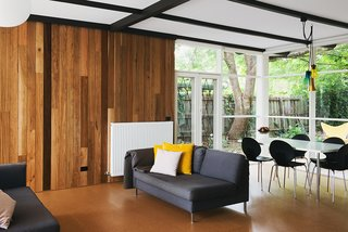 An Australian Renovation Gives New Life to Midcentury Style - Photo 3 of 14 - Timber clad walls meet cork flooring in the open living room at the center of the home.