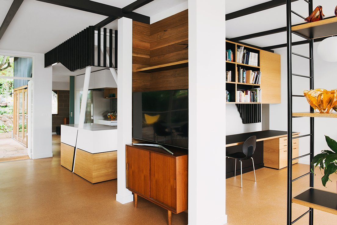 Two angled columns emerge from the kitchen, one of many ways Nest used geometry to divide the space without obstructing views. The architects intentionally opted for oblique angles that would provide a variety of different views depending on the angle. Tagged: Office, Chair, Study, and Shelves.  Midcentury Homes by Dwell from An Australian Renovation Gives New Life to Midcentury Style