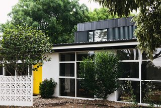 An Australian Renovation Gives New Life to Midcentury Style - Photo 1 of 14 - The yellow hue on the front door is a detail that Nest Architects picked up from the original design. So is the block wall.