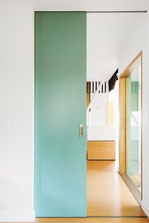 An Australian Renovation Gives New Life to Midcentury Style - Photo 5 of 14 - Sea green details appear throughout the house, peeking out from behind the exterior screen or on interior partitions.