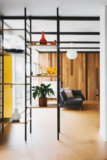 An Australian Renovation Gives New Life to Midcentury Style - Photo 6 of 14 - Open shelving lends an organizing grid without obstructing views.