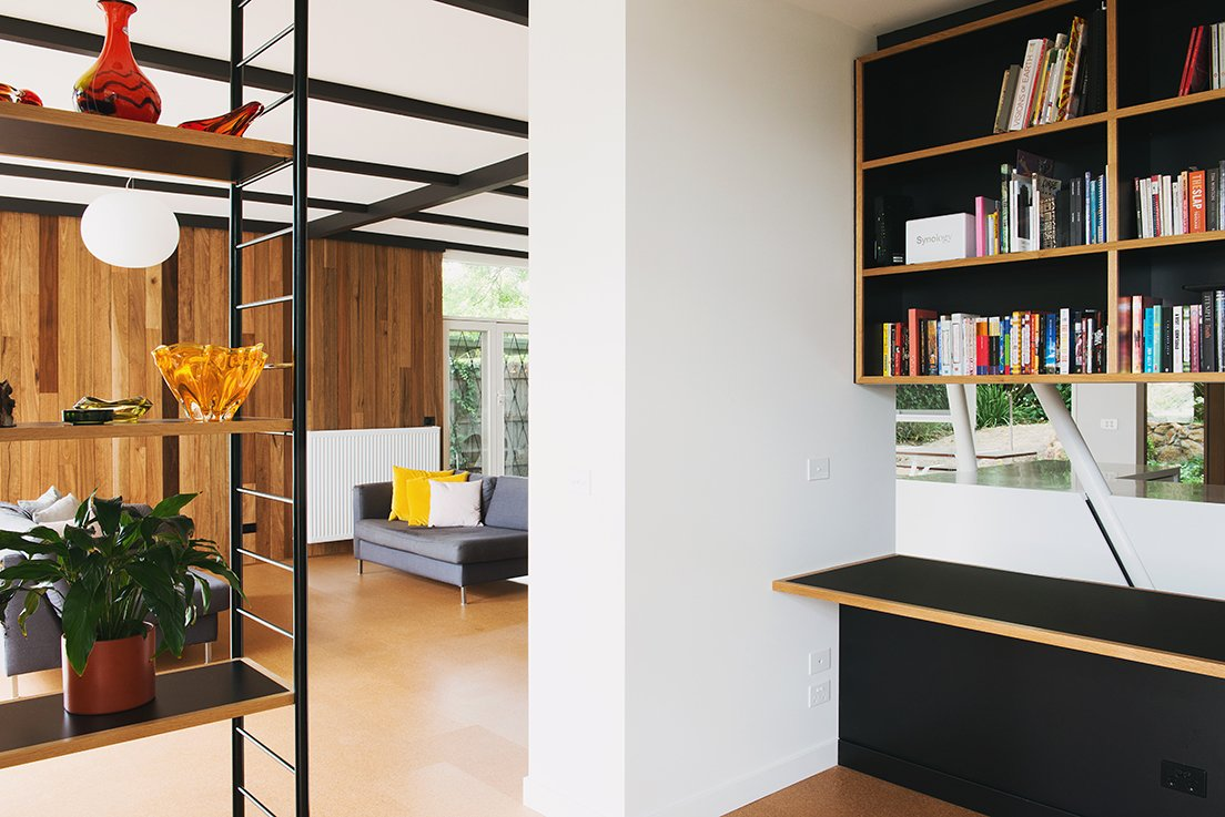 The built-in cabinetry reverses the home's usual organizational motif of a black grid against a timber frame.  Photo 8 of 15 in An Australian Renovation Gives New Life to Midcentury Style