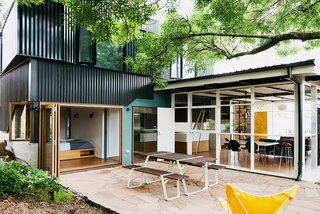 An Australian Renovation Gives New Life to Midcentury Style - Photo 11 of 14 - The result is a multipurpose living area that opens up to an exterior courtyard anchored by aRoss Gardam Flint table.