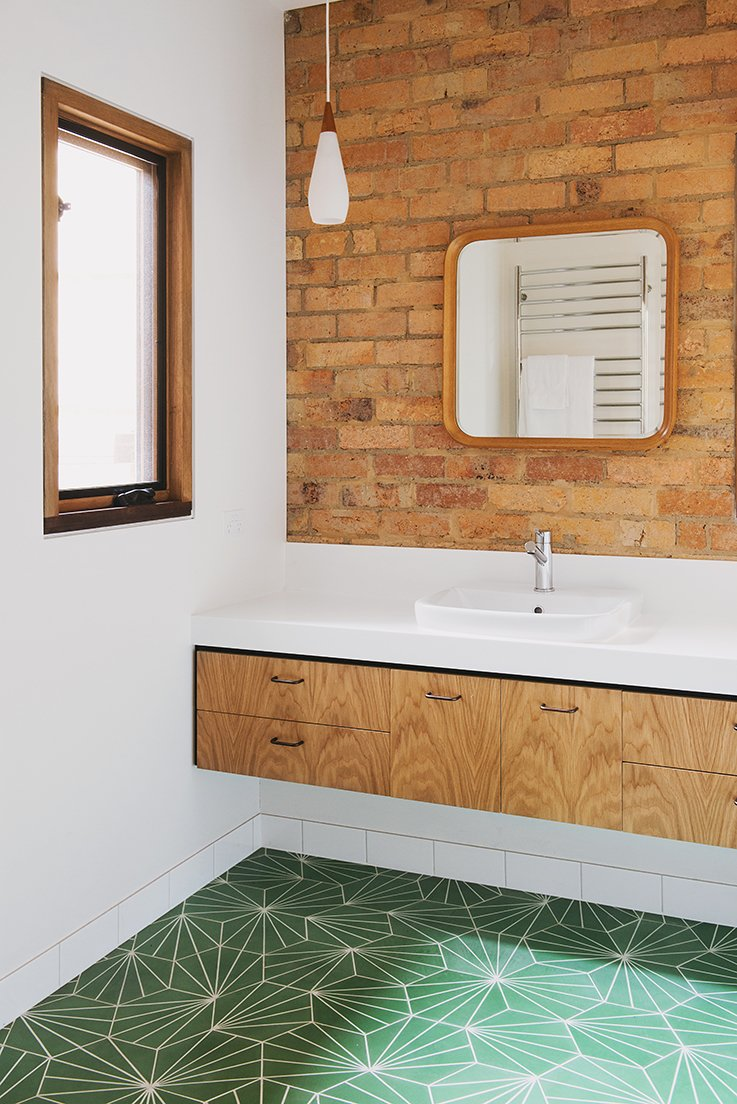 The residents chose the bathroom's Pikralida Green tiles from Tilenova in Sydney. Tagged: Bath Room.  Midcentury Homes by Dwell from An Australian Renovation Gives New Life to Midcentury Style