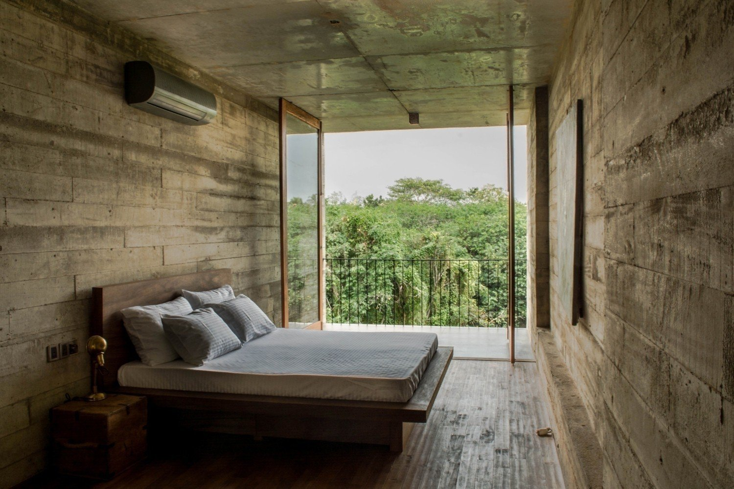 Tagged: Bedroom, Bed, and Concrete Floor.  Photo 1 of 7 in An Architect's Home and Studio Rises Above Rajagiriya