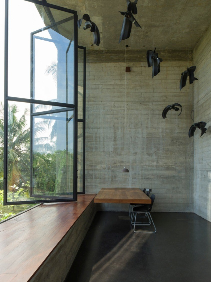 Among the most dramatic spaces is the double-height office with sculptural installation. Tagged: Study, Chair, Desk, Windows, and Metal.  Photo 7 of 7 in An Architect's Home and Studio Rises Above Rajagiriya