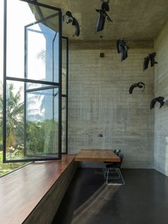 An Architect's Home and Studio Rises Above Rajagiriya - Photo 6 of 6 - Among the most dramatic spaces is a double-height office off of the main studio space with sculptural installation that showcases its soaring ceiling.