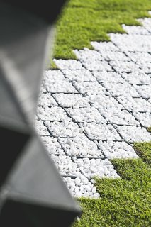 Stay in This 3D-Printed Tiny House - Photo 2 of 19 - A pebble path echoes the patterns of the printed cells and the concrete that fills them.
