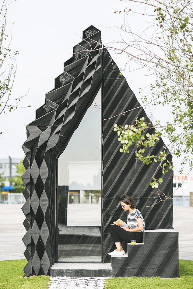 The architects used a number of different geometric designs on the facade to showcase the variety that can be achieved with the technique, while also optimizing insulation and material consumption.   Photo: Sophia van den Hoek  Photo 1 of 19 in Stay in This 3D-Printed Tiny House from Book a Stay in This 3D-Printed Tiny House