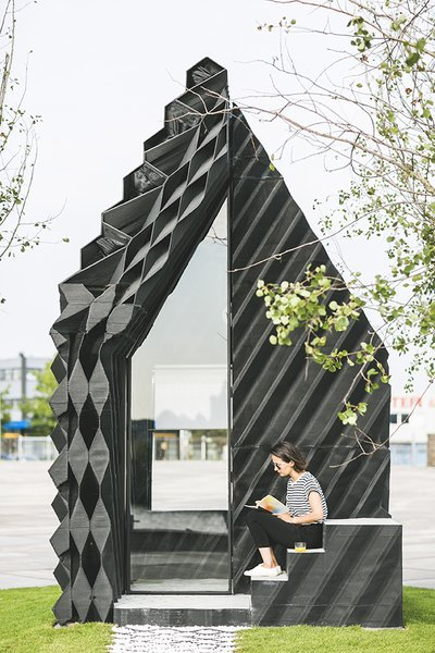 The architects used a number of different geometric designs on the facade to showcase the variety that can be achieved with the technique, while also optimizing insulation and material consumption.   Photo: Sophia van den Hoek