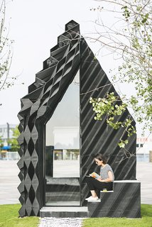 Stay in This 3D-Printed Tiny House - Photo 1 of 19 - The architects used a number of different geometric designs on the facade to showcase the variety that can be achieved with the technique, while also optimizing insulation and material consumption.