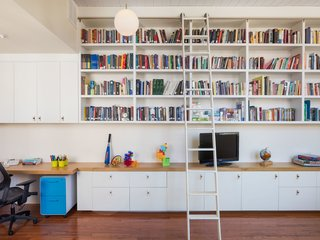 Philadelphia Row House Renovation - Photo 2 of 8 - A ladder leads to built-in book shelves.