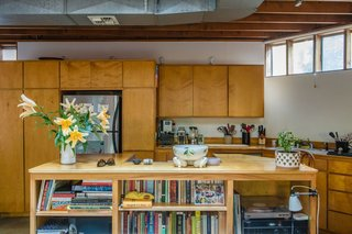The house is made of simple off-the-shelf materials. The beams are standard two-by-fours and the floors on the first level are polished concrete.
