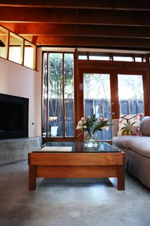 Peek Inside the Frank Gehry Rental of an Emerging L.A. Furniture Designer - Photo 9 of 11 - Kristin, who often creates custom projects for private clients, designed the Horizon coffee table as a birthday gift for William. Its glass and teak are meant to recall the materials in the house.