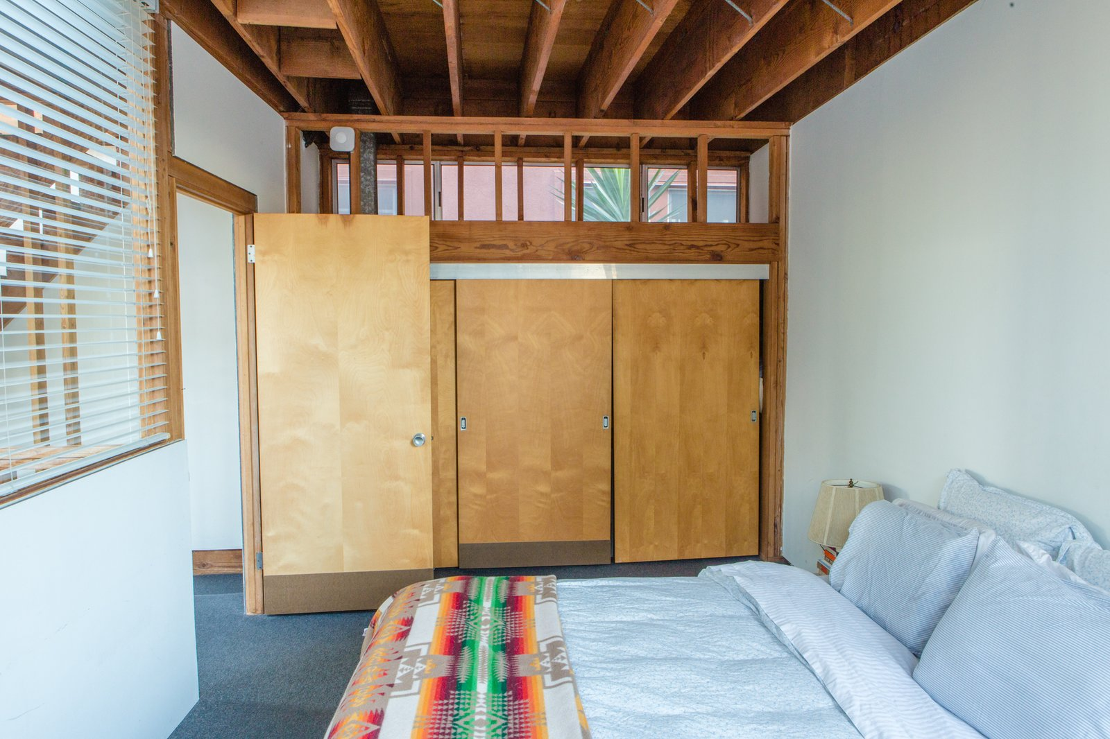 The second floor is home to a simple bedroom.  Photo 7 of 12 in Peek Inside the Frank Gehry Rental of an Emerging L.A. Furniture Designer