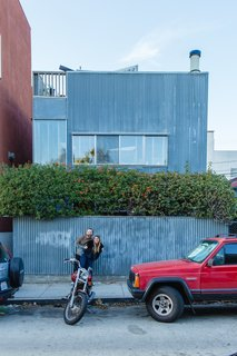 William Fowler and Kristin Grant Fowler of Dust to Dust Furniture outside their home in Frank Gehry's 1980 corrugated-iron Spiller House in Venice Beach, California.