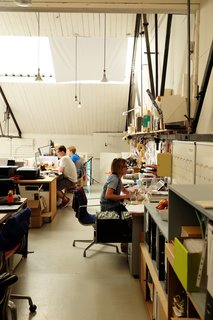 Meet the London Furniture Designers Working in a Reclaimed Railway Shed - Photo 5 of 11 - The design team works in the mezzanine, which is reached by a spiral staircase. Here they make models, finish in-house products, and work on prototypes.