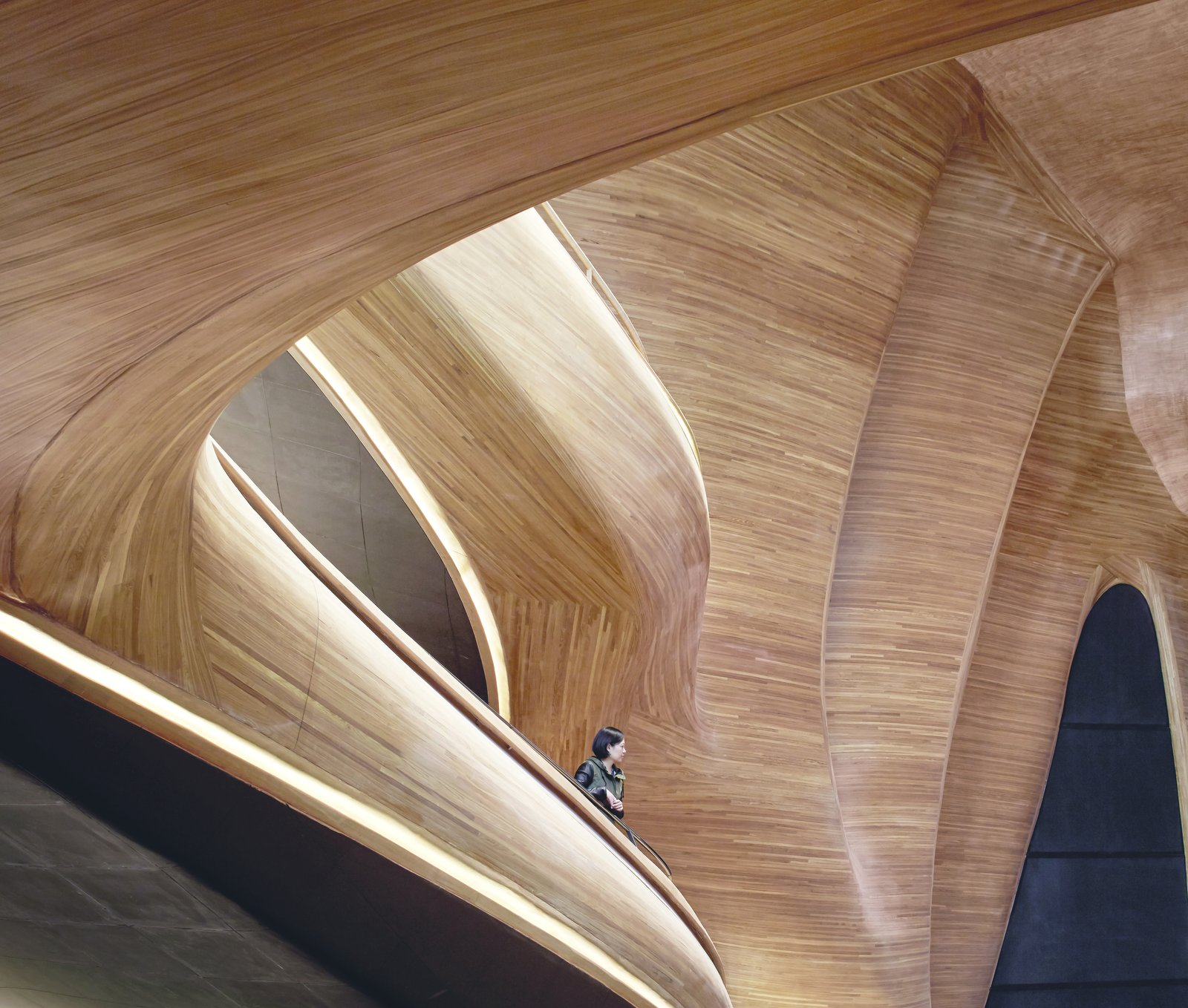 Set within a crystalline aluminum shell on a harsh tundra, the Grand Theater of China's Harbin Opera House (2009–2015) by MAD Architects provides an organic contrast to its exterior. Meant to evoke a block of naturally eroded wood, the space is lined in Manchurian ash, a move that enhances the acoustics of the space, while also supporting the local artisan community.   Picture by Hufton + Crow   Discover the Fantastical Future Vision of a Beijing Architect by Heather Corcoran