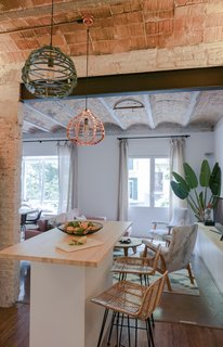 A Barcelona Apartment Gets a Softly Modern Renovation - Photo 4 of 8 - The open kitchen is the centerpiece of the renovated apartment. Bloomint designed the island.