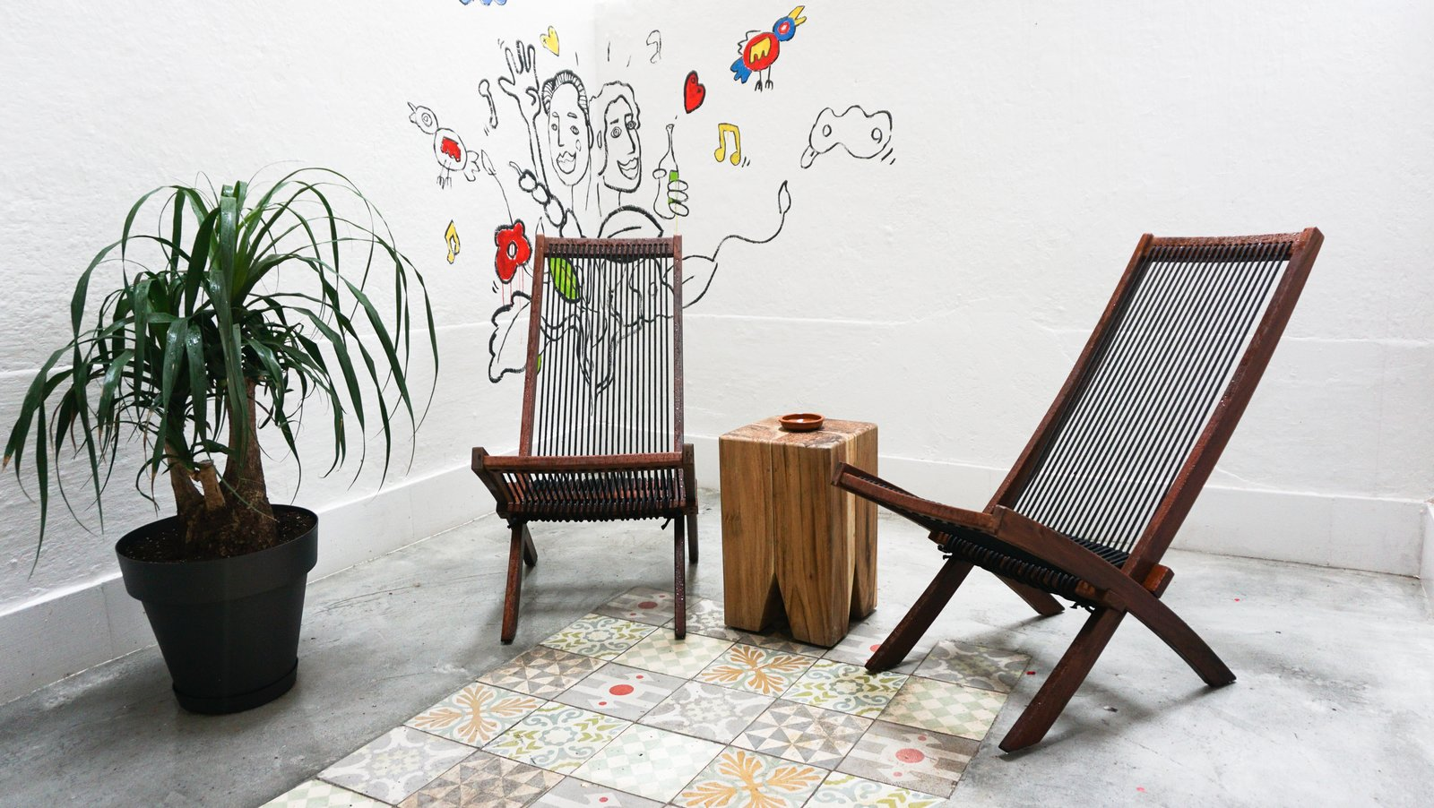 The patio features a cement floor inlaid with traditional <i>baldosa hidráulico</i> tiles by Pinar Miro. A friend of the resident painted the mural.  Photo 8 of 9 in A Barcelona Apartment Gets a Softly Modern Renovation