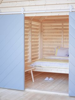 Book It: A Shoppable Finnish B&B Pops Up in Paris - Photo 1 of 5 - Designed by Linda Bergroth, the spruce timber structures are meant to evoke the simple pleasures of <i>aitta</i>, traditional Finnish country houses.