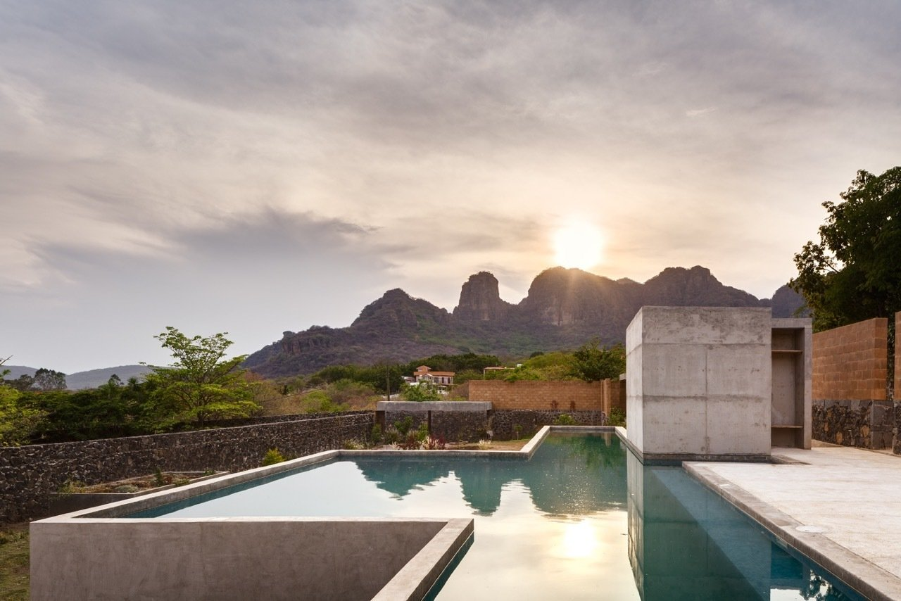 The modern house responds to the local landscape in an exciting new way. Tagged: Outdoor, Large Pools, Tubs, Shower, Swimming Pools, Tubs, Shower, and Concrete Pools, Tubs, Shower.  Photo 8 of 8 in An Eco-Friendly Getaway Built With the Future in Mind