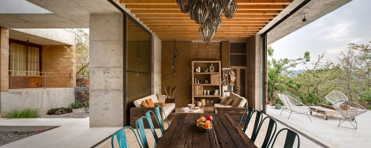 Thanks to the temperate climate, living and dining areas are able to be open to the surrounding environment. An Eco-Friendly Getaway Built With the Future in Mind - Photo 6 of 8