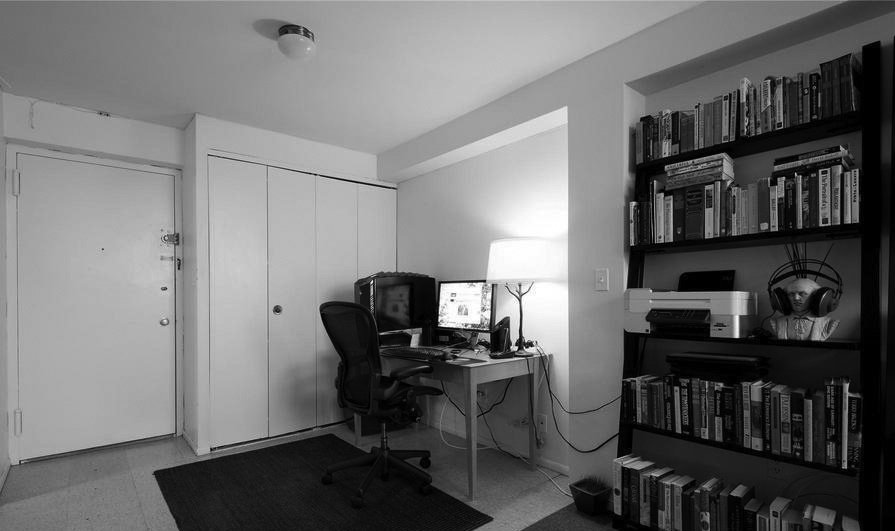 Before the entrance was overwhelmed by a desk and task chair that prevented access to the main closet.  Photo 7 of 11 in In Just 450 Square Feet, A New York Architect Crafts a Multifunctional Apartment of His Own