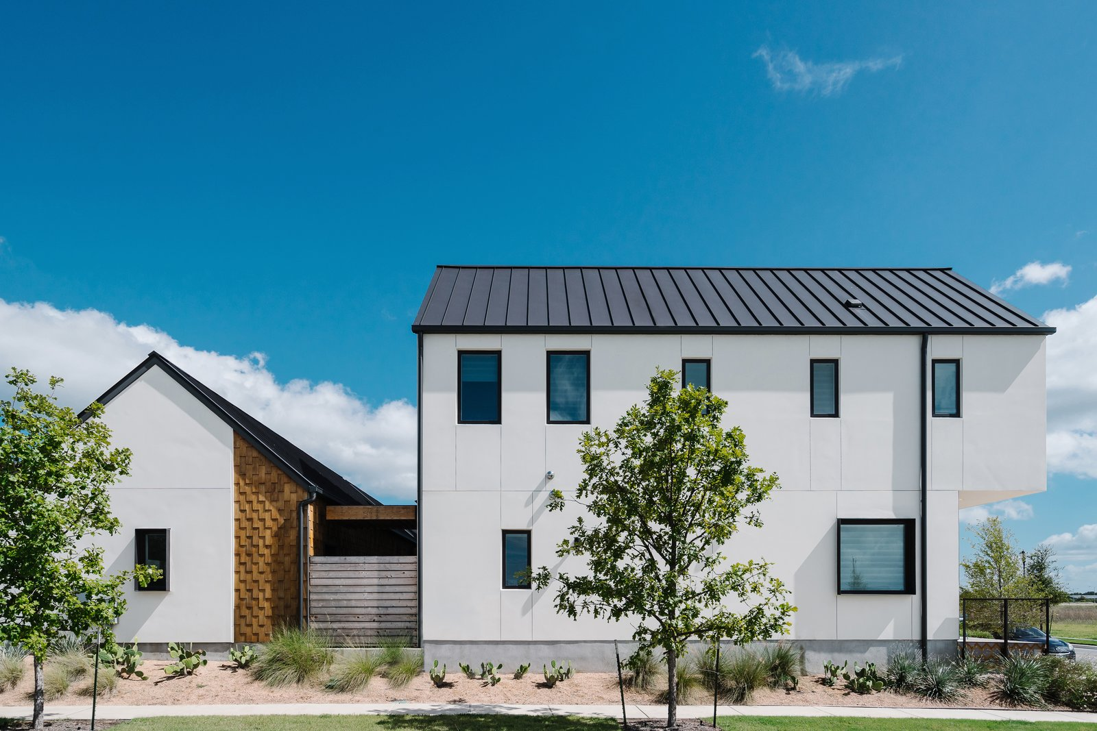 Sustainability is the Centerpiece of This New Austin Development - Photo 1 of 6 - At the back of the houses, cedar shingles provide an unexpected moment of visual interest.