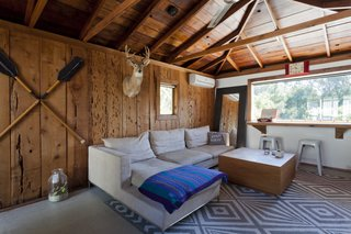 Graphic Design Inspired This Handcrafted Canyon Hideaway - Photo 10 of 10 - Though brightening the house was a top priority, the couple kept the original cedar cladding and raw redwood ceiling in the guest house as a nod to the home's original style.