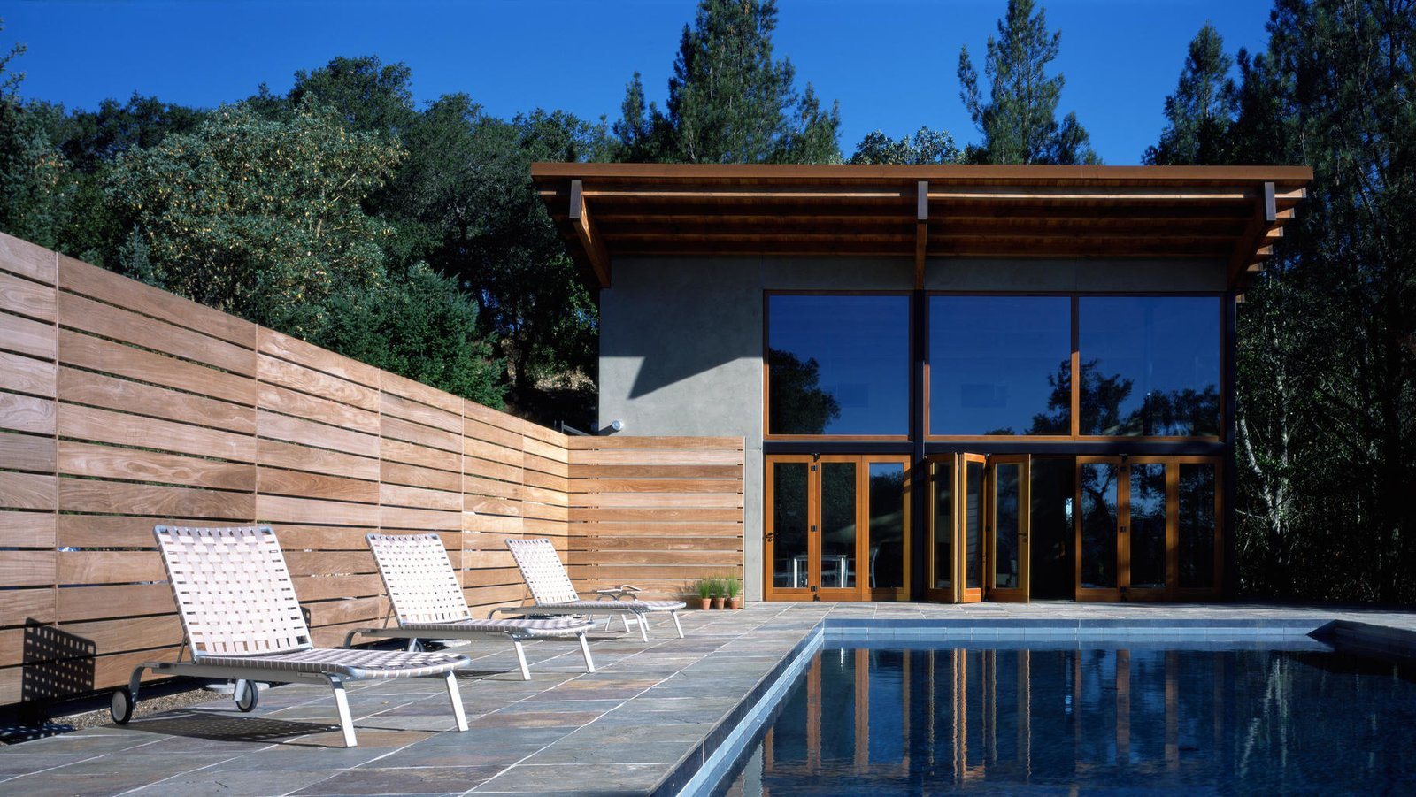 #pool #poolhouse #calistoga #exterior #smallspaces #cantileveredroof #cantilevered #roof #glass #windows