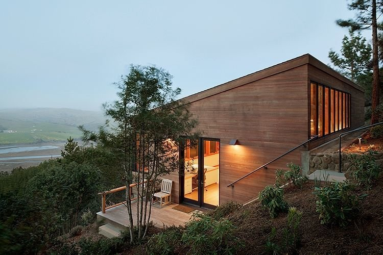 On a scenic one-acre site in Inverness, California, Richardson Architects planted an artist studio in a hillside overlooking a coastal vista. The client, a painter who lives on the property, requested the addition be situated downhill from the main residence to create distance between work and home. Tagged: Exterior, House, Cabin Building Type, Wood Siding Material, and Shed RoofLine.  Photo 2 of 4 in The View at This Art Studio Could Inspire a Masterpiece