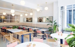 "A Healthy Manhattan Eatery Plants a Pink Flag in Boston - Photo 2 of 2 - Most of the furniture is custom by ASH NYC. Surrounding the white oak and Carrara marble tables are chair-bench hybrids that ASH calls ""Chenches""."